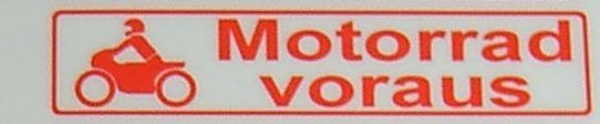"""Text label """"motorcycle ahead"""", red, 1: 10 self"""